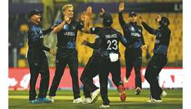 Namibia's Ruben Trumpelmann (second from left) celebrates after the dismissal of Scotland's Calum Ma