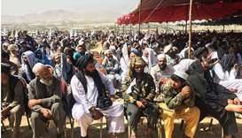Taliban supporters attend an open air rally in a field in Kabul