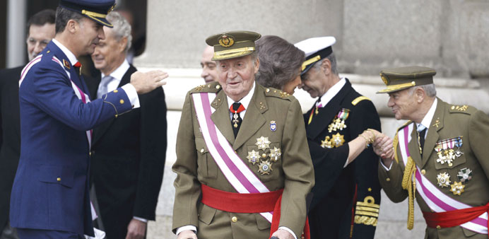 Spanish king presides over military parade in crutches