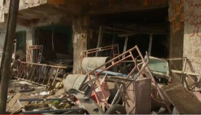 Aftermath of bomb attack in al-Ameen area of Baghdad on August 2, 2015