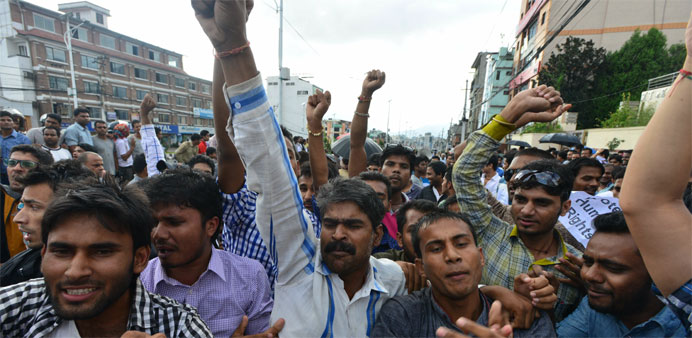 Nepalese activists of the Madhesi group chant slogans against the proposed constitutionat near parli