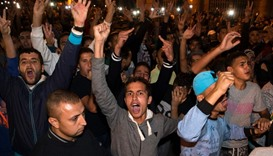 Protesters shout slogans in the northern city of Al Hoceima  following the death Mouhcine Fikri