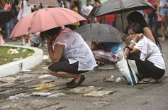 Church protests killings as Filipinos honour the dead
