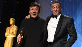 Honoree Jackie Chan (L) poses with actor Sylvester Stallone