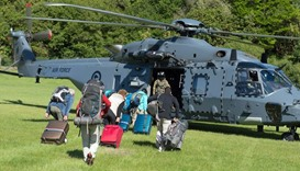 A New Zealand Defence Force helicopter evacuating some of 1,200 of tourists from Kaikoura
