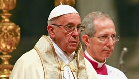 Pope Francis leads a consistory ceremony to install 17 new cardinals in Saint Peter's Basilica at th