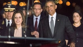 US President Barack Obama (2nd R) walking with Peru's Vice President Mercedes Araoz (2nd L) upon his