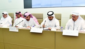 Al-Kaabi (third left) and Dr al-Derham (fourth left) sign the agreement to develop a STEM mobile lab