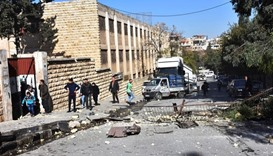 A view shows the damage outside a school after shelling by Syrian rebels on Aleppo.
