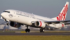 Australian teenager sues airline over mid-flight coffee spill