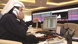 Qatar shares edge lower amid lower buying interests