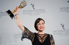 Christiane Paul cries as she holds the Emmy award in the Best Performance by an Actress category