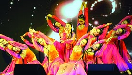 Chinese performers in colourful dress on stage.