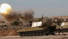 An Iraqi fighter fires artillery towards Islamic State militants, in Ali Rash southeast of Mosul, Ir
