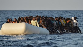 migrants and refugees on a rubber boat