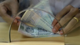India hopes to cut losses from rupee fall with reserves