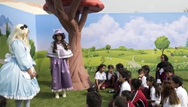 Alice in Wonderland characters welcome young visitors, who were joined by HE Sheikha Hind bint Hamad
