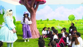 Alice in Wonderland characters welcome HE Sheikha Hind bint Hamad al-Thani and young visitors