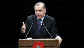 Turkish President Recep Tayyip Erdogan addresses a speech