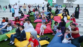 Children and their parents lounge at a storytelling booth. PICTURE: Jayan Orma.