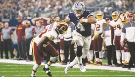 Prescott catches fire as Cowboys win 10th straight