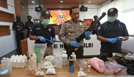 Indonesian police show items recently seized, including weapons and bomb-making materials