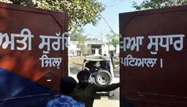 An Indian police personnel stands at the gate of the Nabha maximum-security jail in Nabha