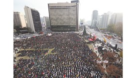 Thousands of protesters gather during an anti-government rally demanding the resignation of South Ko