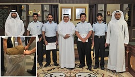 Ahmed bin Ali al-Muhannadi and other officials. Inset: Some of the seized marijuana.