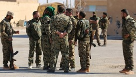 Syrian Democratic Forces (SDF) gather in the town of Ain Issa