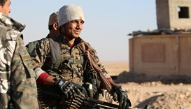 Members of US-backed Kurdish-Arab forces deploy on the frontline, one kilometre from the Syrian town