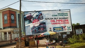 An advertising board concerning the oil pipeline vandalization in Warri, Nigeria