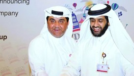 Al-Obaidli (left) and al-Mohannadi cut a cake to mark the launch of Ezdan World Company. PICTURE: Sh