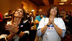 Donald Trump supporters in Phoenix, Arizona, react as the president-elect gives acceptance speech