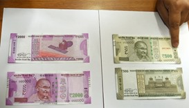 New 500 and 2000 INR notes are displayed at the Reserve Bank of India (RBI)