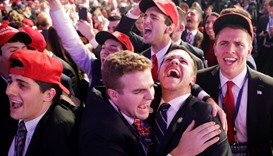 People cheer as voting results for Iowa come in at Trump's election night event at the New York