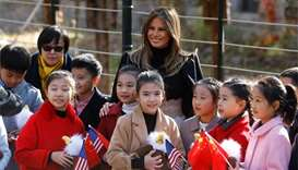Melania plays tourist as Trump departs Beijing