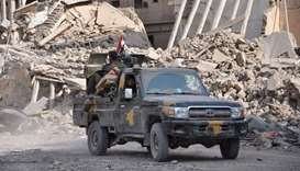 Syrian pro-government forces patrol in the eastern city of Deir Ezzor on November 4, 2017