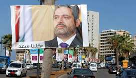 Posters depicting Lebanon's Prime Minister Saad al-Hariri, who has resigned from his post, are seen