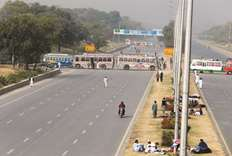 Protesters stage sit-in on highway
