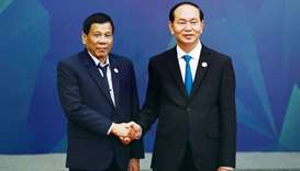 Vietnam's President Tran Dai Quang (right) welcomes Philippines' President Rodrigo Duterte at the AP