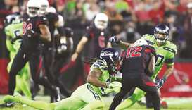 Seahawks top Cards, Sherman likely out for season