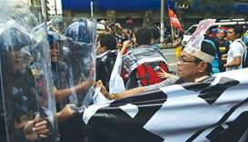 Protesters scuffle with riot police as they try to march towards the US embassy, ahead of the 31st S
