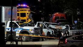 Police investigate a pickup truck used in an attack on the West Side Highway in Manhattan, New York,