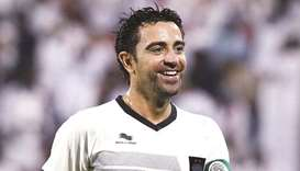 Al Sadd's Xavi to play on until at least end of year