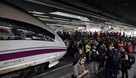 Protesters block train tracks at the Sants Station in Barcelona during a strike called by a pro-inde