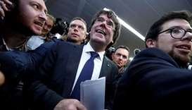 Sacked Catalan leader Carles Puigdemont departs after a news conference at the Press Club Brussels E