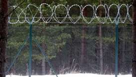 A fence on the border with Russia is seen in Katlesi, Latvia