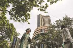Sensex closes at record high; rupee strengthens to 64.60