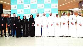 Officials of Nama Centre, Doha Festival City and some of the participants at the Souq Nama